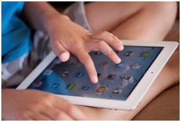 Kid on iPad following digital parenting tips